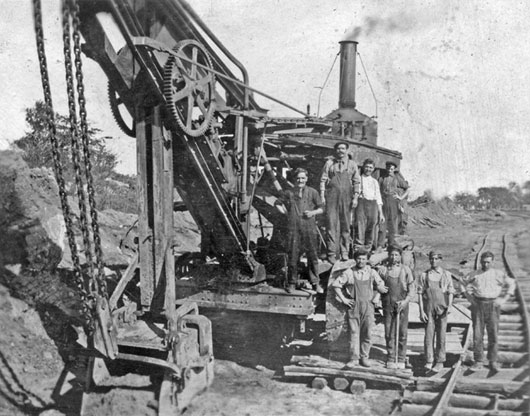 Steam shovel and crew. Steam boiler is on rear of shovel. Courtesy of M. DeMattia