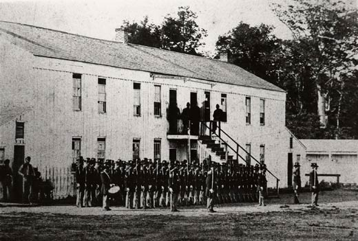 Company C, 128th OVI in front of barracks building near main stockade Gate. Taken circa 1864. From the Frohman Collection, Hayes Presidential Center.